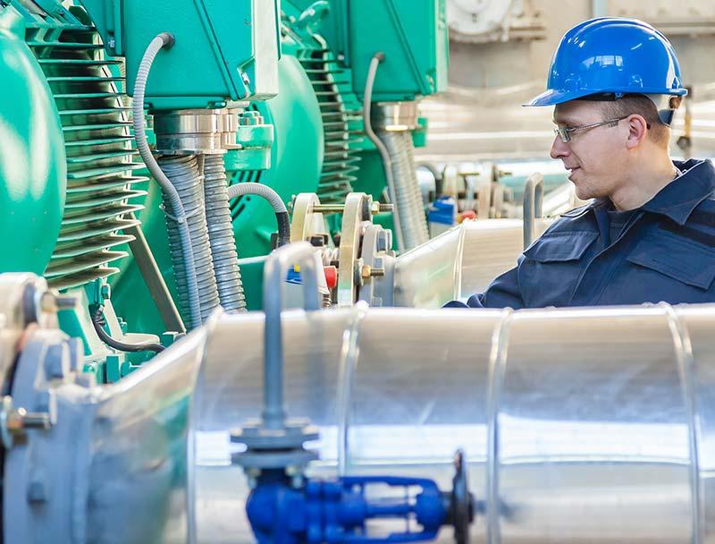 Industrial refrigeration engineering looking at equipment