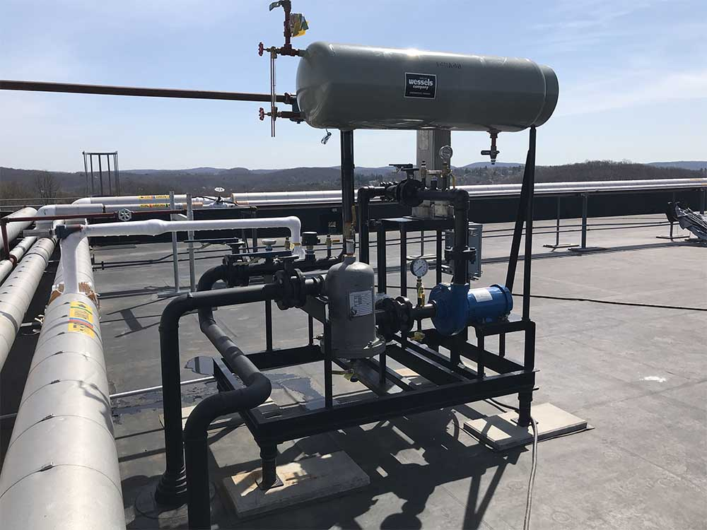 Refrigeration piping and tanks on roof