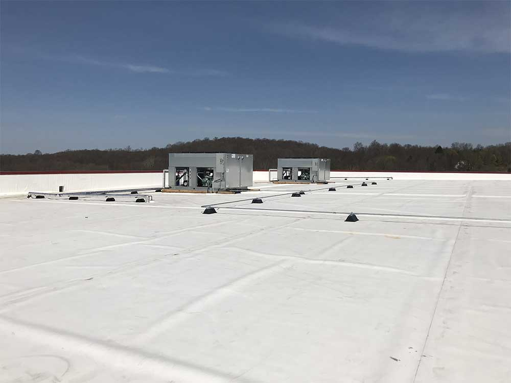 2 Refrigeration units on roof of warehouse