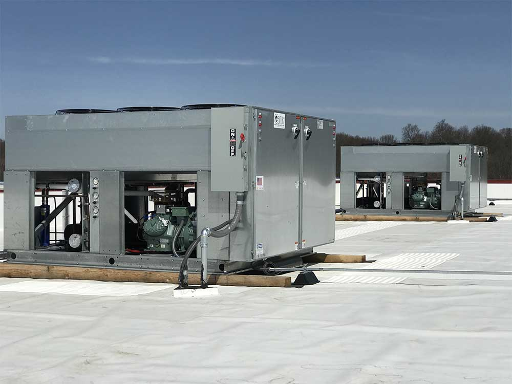 Close up of 2 Refrigeration units on roof of warehouse