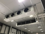 Refrigeration cooling unit on ceiling of warehouse