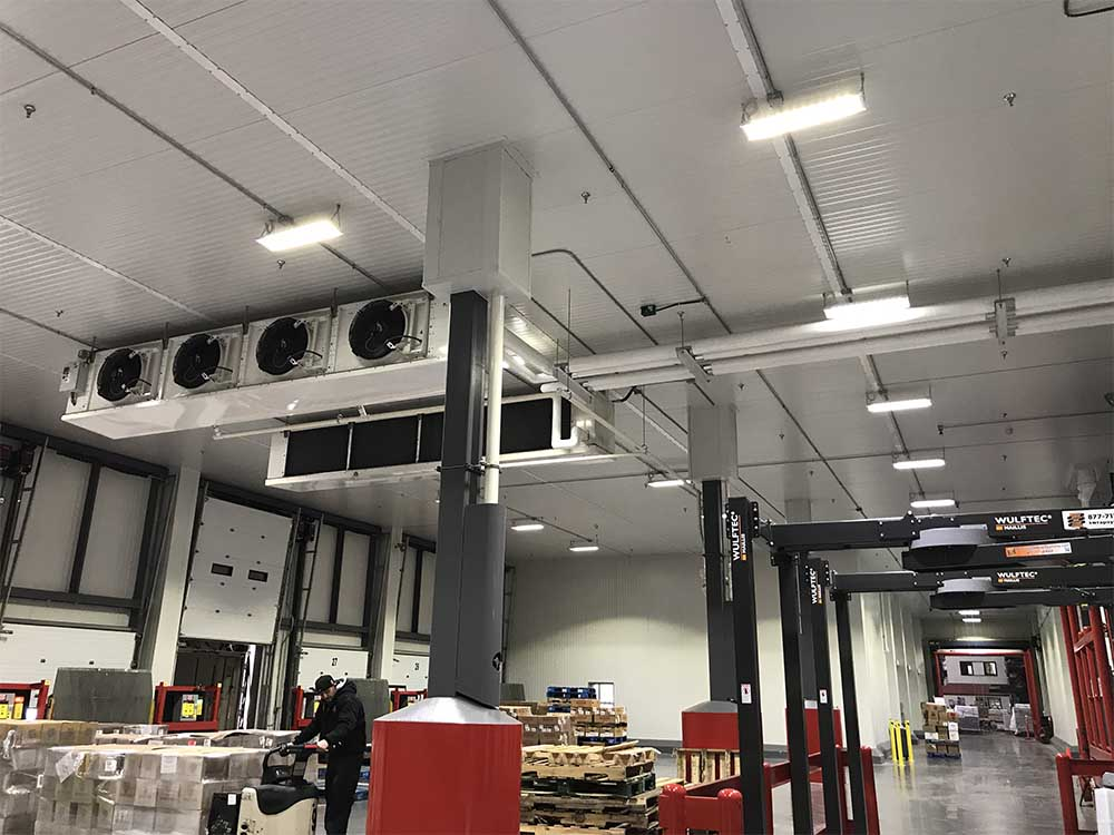 Refrigeration unit on ceiling of warehouse